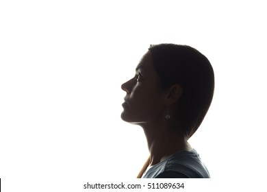 Young woman looking up - horizontal silhouette of a side view