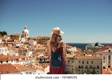 Young woman looking at Lisbon Panorama in Portugal