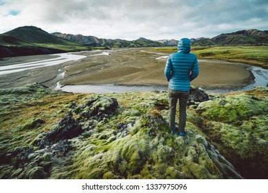 young woman looking at majestic icelandic landscape