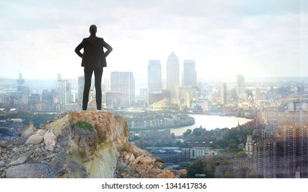 Young woman looking over the City of London at sunset. Future, new business opportunity and business success concept. London, UK