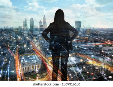 Young woman looking over the City of London. London covered by wifi connections. Neon lights