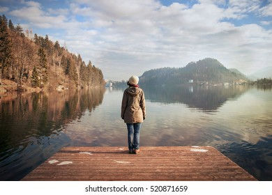 young woman looking over the lake, winter atmosphere in Bledâ??s lake