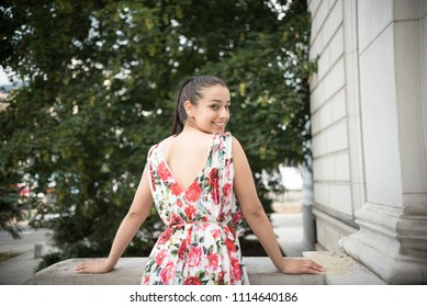 young woman looking over shoulder
