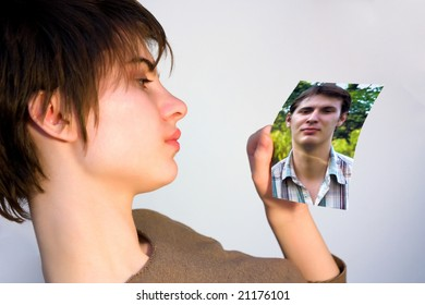 young woman looking at a picture of a man