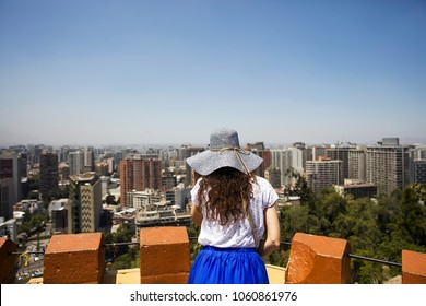 Young woman looking at Santiago de Chile from Santa Lucia Hill