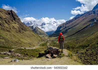 Young woman looking at the scenic view during the Salkantay trek