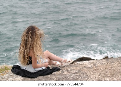 young woman looking at the sea on coast