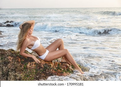 Young woman looking at sea. Sunset time outdoor portrait made in India, State Goa