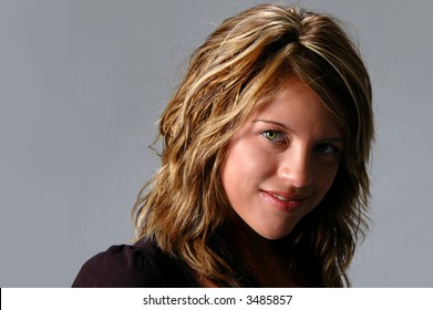 Young woman looking straight over a neutral background
