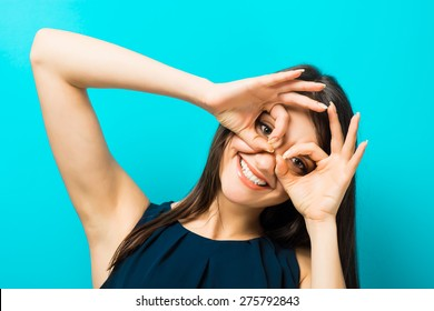 young woman looking through imaginary binocular