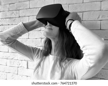 Young woman looking through virtual reality device