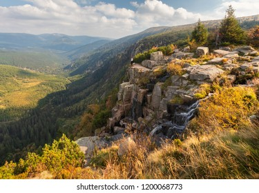 Young woman looking to the valley of Elbe valley in Krkonose Mountains from pancava falls, Czech Republic