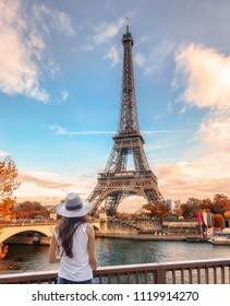 Young woman looking view of Eiffel tower at Paris in autumn season
