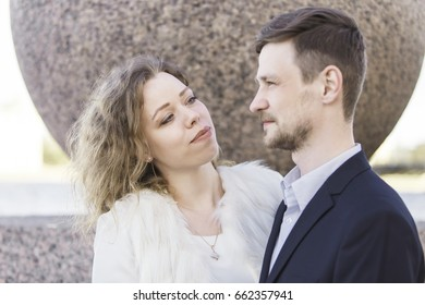 Young woman looks intently at her man