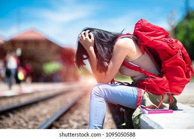 young woman lost and disappointed in missing train departure earlier than expect, late trip in worry, upset travelling, disappoint in late comming CONCEPT