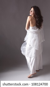 Young Woman in Lovely White Nightgown