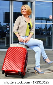 Young woman with luggage at the airport. Traveling tourist.