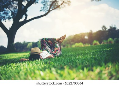 Young woman lying down on grass. relax time.