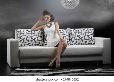 Young woman is lying on a couch .Fashion colors. Fine art.