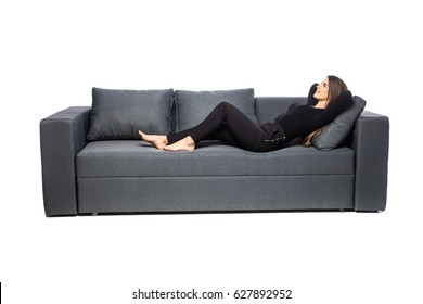 Young woman lying on couch on white background