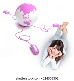 Young woman lying on the floor by a pink world globe connected to three mouses