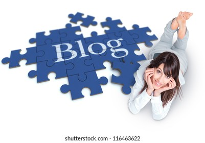 Young woman lying on the floor with a puzzle forming the word Blog