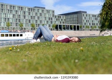 young woman lying on river