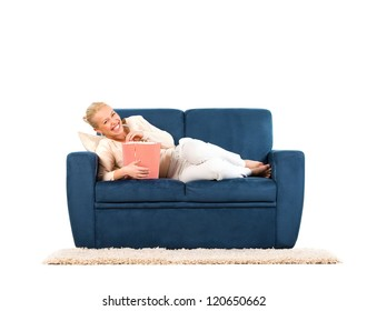Young woman lying on a sofa eating popcorn