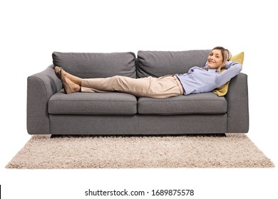 Young woman lying on a sofa isolated on white background