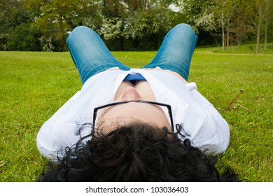 Young woman lying showing cleavage