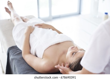 Young woman lying at the spa salon