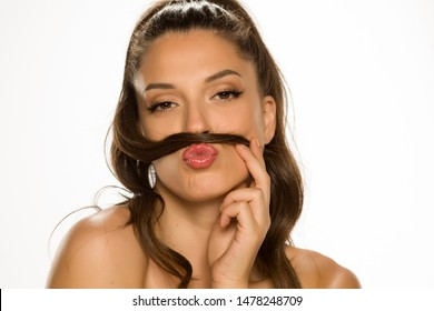 Young woman make a mustaches with her hair