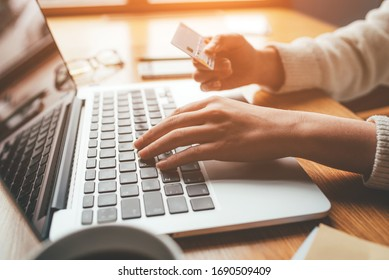 A young woman makes an online payment for a purchase. Online shopping.