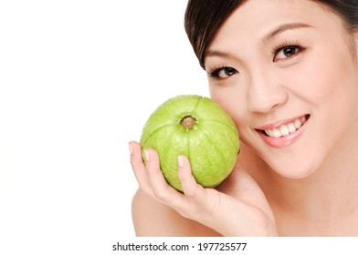 young woman make-up holding guava fruit close up,