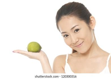 young woman make-up and holding lemon