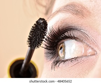 Young woman makeup with mascara eye closeup