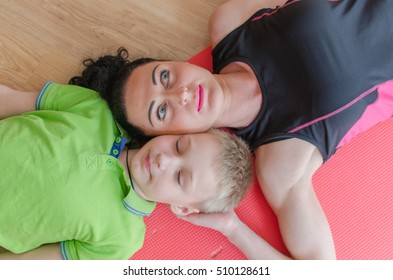 Young woman is making exercises with her son