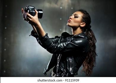 Young woman making fashion self portrait.