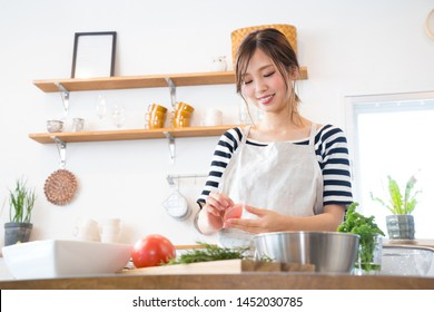 Young woman making food in the kitchen