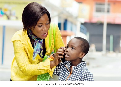 young woman making listen her communication by her child.
