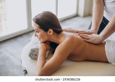 Young woman making massage at spa center