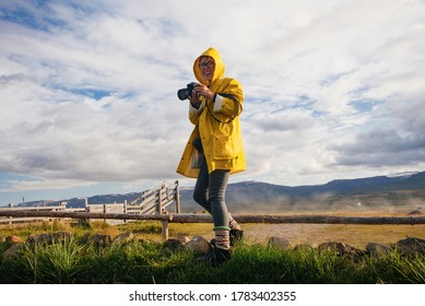 Young woman making photo in Iceland