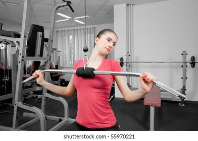 young woman making physical exercises in a fitness center