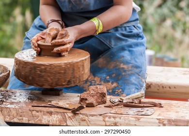 Young woman making pottery