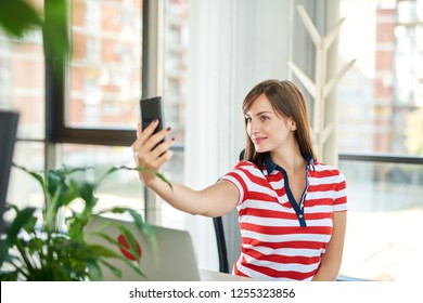 Young woman making selfie in the office