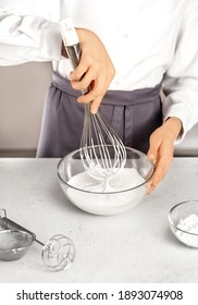 Young woman making whipped cream. Delicious food concept. Great design for any purposes.