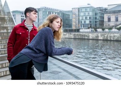 young woman and man hanging out by the river Spree in Berlin, Germany