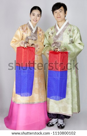 4934cdea5 young woman and man in korean traditional clothing holding lamp,  cheongsachorong