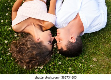 young woman and man  lying on grass