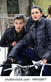 young woman and man on bicycle